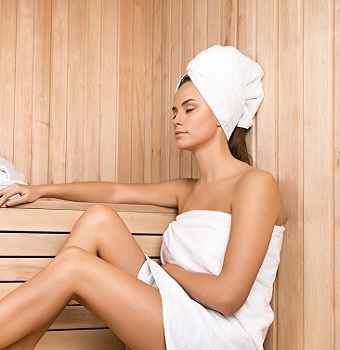 Woman Sitting in Infrared Sauna